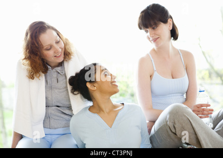 Smiling women talking in gym - Stock Photo