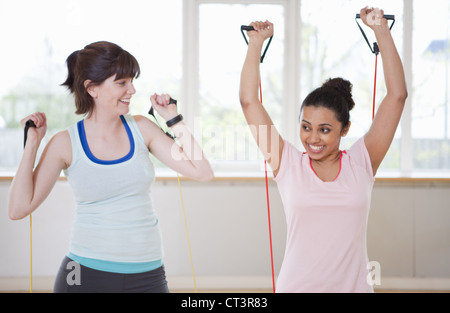 Women stretching in gym - Stock Photo