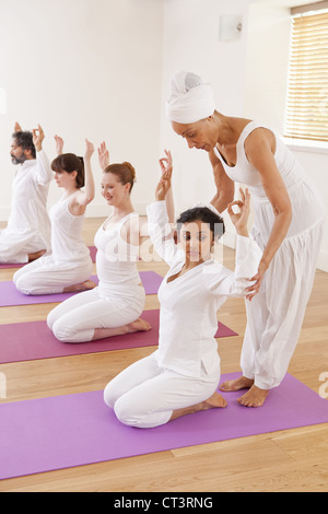 People practicing yoga together in class - Stock Photo