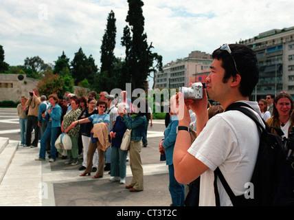Athens, tourists visit the Athens parliament - Stock Photo