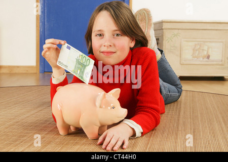 CHILD WITH MONEY - Stock Photo