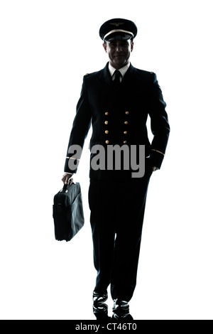 one caucasian man in airline pilot uniform  in studio isolated on white background - Stock Photo