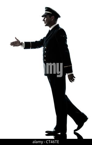 one caucasian man in airline pilot uniform walking handshake silhouette in studio isolated on white background - Stock Photo