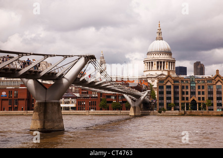 London Millenium Bridge looking towards St Pauls Cathedral. - Stock Photo
