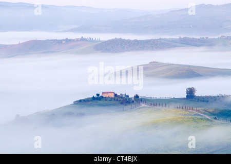 Pienza, Tuscany - Early morning misty view from Pienza towards  Val d'Orcia in May - Stock Photo