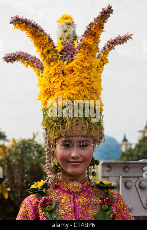 Indonesia, Sumatra, Aceh, Banda Aceh. Woman in traditional dress wearing a floral crown headdress. - Stock Photo