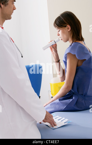 BREATHING, SPIROMETRY IN A WOMAN - Stock Photo