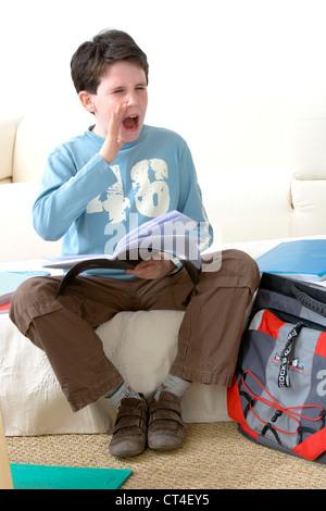 CHILD DOING HOMEWORK - Stock Photo