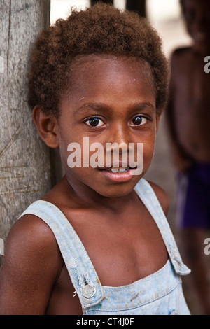 Oceania, Solomon Islands, Utupua. Close-up shot of young boy. - Stock Photo