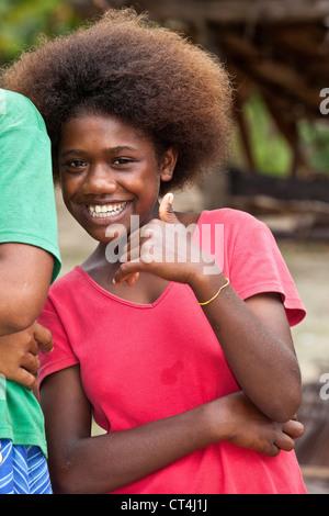 Oceania, Solomon Islands, Utupua. Close-up shot of young girl. - Stock Photo