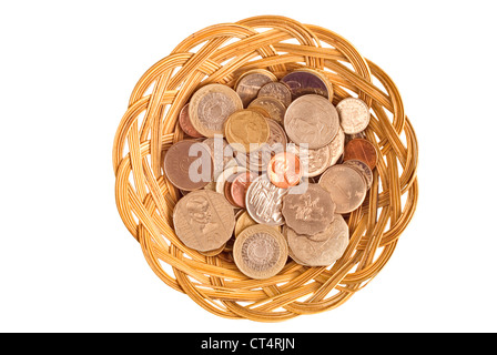 Mixed international coins in a simple cane basket. - Stock Photo