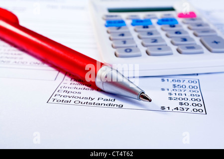 Bill for several hundred dollars, calculator and pen, - Stock Photo