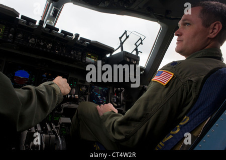 Pilots of the US Air Force in the cockpit of a C-17 transport jet at the Farnborough Air Show, UK. - Stock Photo