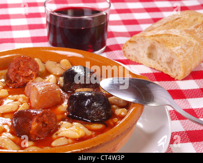 Fabada Asturiana. Traditional Spanish meal native from Asturias Region. Made with White Beans, red spicy sausage, - Stock Photo