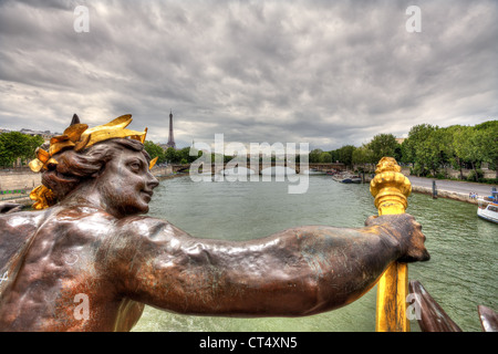 View on Seine river and Eiffel Tower from famous Alexander the III bridge in Paris, France. - Stock Photo