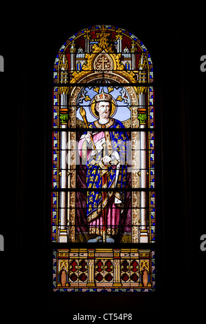 Stained glass window in the San Jeronimo el Real Church in Madrid, Spain. - Stock Photo