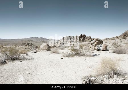 Graffiti covered rocks in the Mojave Desert, California,USA. - Stock Photo