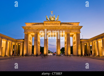 Brandenburg gate Pariser Platz with the winged Quadriga statue on top at sunset Berlin city centre Germany EU Europe - Stock Photo