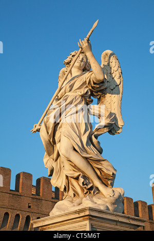 Bernini's marble statue of angel with spear from the Sant'Angelo Bridge in Rome, Italy - Stock Photo