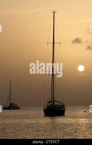 Sailboat at anchor in Bequia - Stock Photo