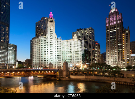 Night-time view of the Michigan Avenue Bridge (officially DuSable Bridge) and the Wrigley building and Tribune Tower - Stock Photo
