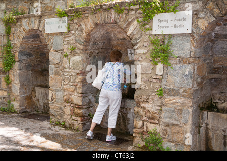 Tourist filling bottle, fountains of sacred water, House of the Virgin Mary, Meryemana, near Ephesus and Selcuk, - Stock Photo