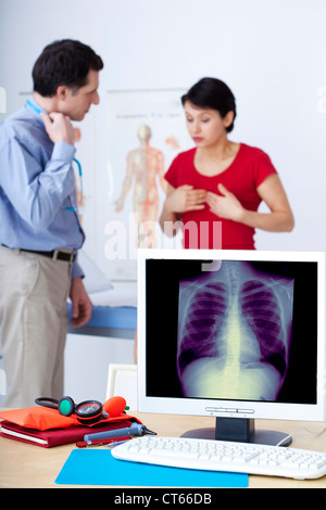 PNEUMOLOGY CONSULTATION WOMAN - Stock Photo