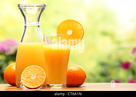 Two glasses of orange juice and fruits - Stock Photo