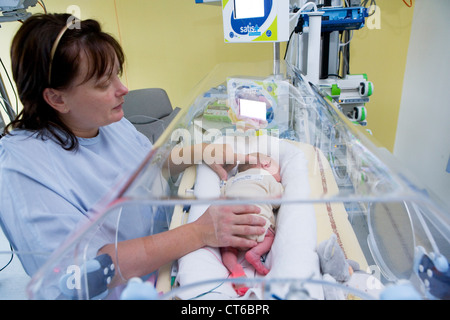 MOTHER AND PREMATURE BABY - Stock Photo