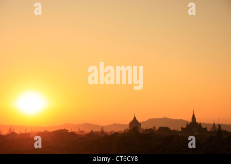 Sunset over temples, Bagan Archaeological Zone, Mandalay region, Myanmar, Southeast Asia - Stock Photo