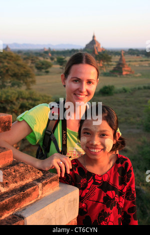 Woman and burmese girl with traditional thanaka paste on her face, Bagan Archaeological Zone, Mandalay region, Myanmar - Stock Photo
