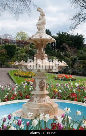 Fountain in the sunken formal garden known as The Dingle, within The Quarry Park on the bank of the River Severn - Stock Photo