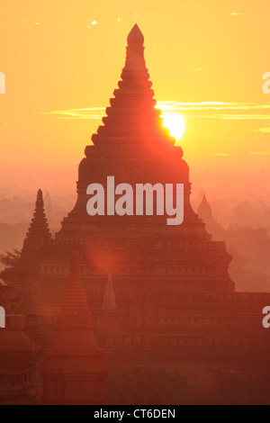 Sunrise over temples, Bagan Archaeological Zone, Mandalay region, Myanmar, Southeast Asia - Stock Photo