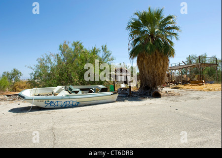 Grounded speed boat Salton Sea Beach,  located on the Eastern shore of the Salton Sea, California,USA. - Stock Photo