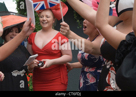 Women UK having fun 2010s Group of girls singing at the bandstand end of the days races Royal Ascot horse racing - Stock Photo