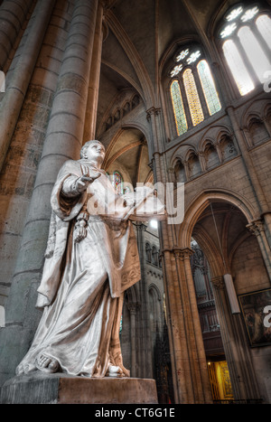 Interior of Saint Denis Basilica with the statue of the man with the book in his hands. Paris, France, Europe. - Stock Photo