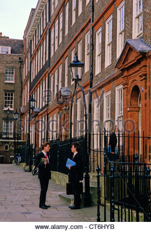 Law students chatting in Kings Bench Walk, Inner Temple, London - Stock Photo