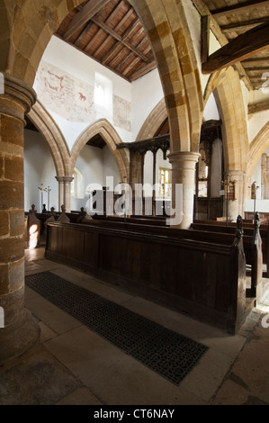 Interior of St Andrew's church with its Medieval wall paintings visible, in the tiny village of Stoke Dry, Rutland, - Stock Photo