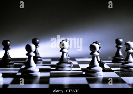 chess pawns on the chessboard - Stock Photo