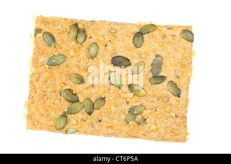 Organic wholegrain crispbread with emmental cheese and pumpkin seeds - Stock Photo
