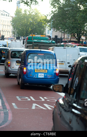 Taxis using a bus lane on a congested street in London, England. - Stock Photo