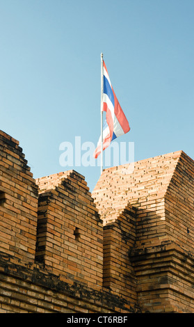flog of thailand flying over the wall in chiang mai - Stock Photo