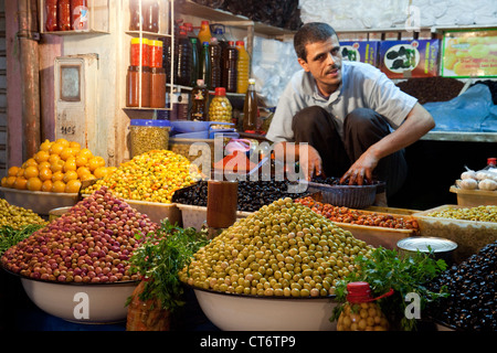 A an selling olives in the market souk, the Medina, Taroudant, morocco Africa - Stock Photo