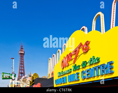 Blackpool tower and seafront amusements Mr t's Golden mile centre  along the Golden Mile on the seafront Blackpool - Stock Photo
