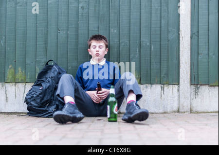 A posed 12 year old boy showing the problems of underage drinking in the Uk - Stock Photo