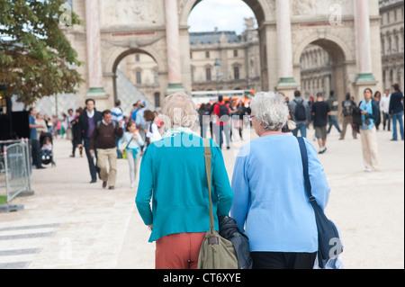 Paris, France - A senior couple of friends tourists visiting Paris. - Stock Photo