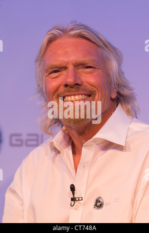 Sir Richard Branson speaks to audience during Virgin Galactic space tourism presentation at Farnborough Air Show. - Stock Photo