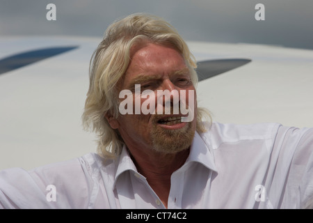 Alongside his SpaceShipTwo vehicle, Richard Branson after Virgin Galactic space tourism presentation at Farnborough - Stock Photo