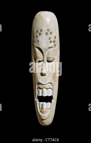 African wooden mask isolated on black background - Stock Photo