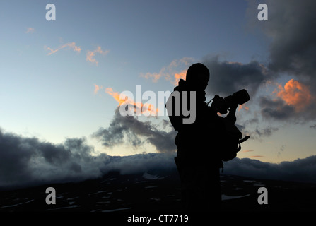 silhouette of photographer in Mutnovsky volcano area on Kamchatka - Stock Photo